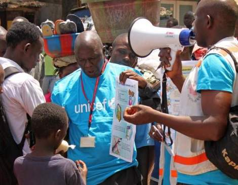 Health workers teach people about the Ebola virus and how to prevent infection in Conakry, Guinea, in March. / Youssouf Bah/Associated Press